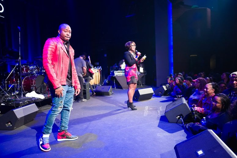 Raheem Devaughn introduces AIDS Health Care Foundation's Senior Director of Media, Marketing & Strategic Partnerships-Samantha Granberry. Photo Credit: Tony Mobley for The LoveLife Foundation
