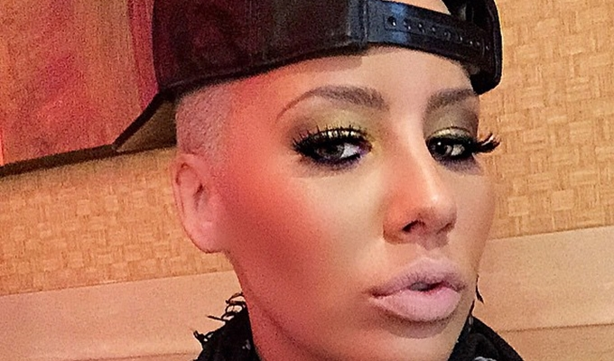 Amber Rose Claps Back at Kanye's '30 Showers' Comment