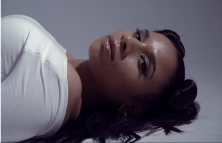 Emerging Singer-Songwriter Iman Highlights Graceful Beauty In 'Naive' Video