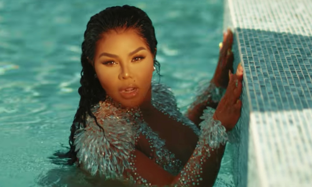 "Lil Kim Unveils Sexy, Tropical Video For ""Nasty One"""
