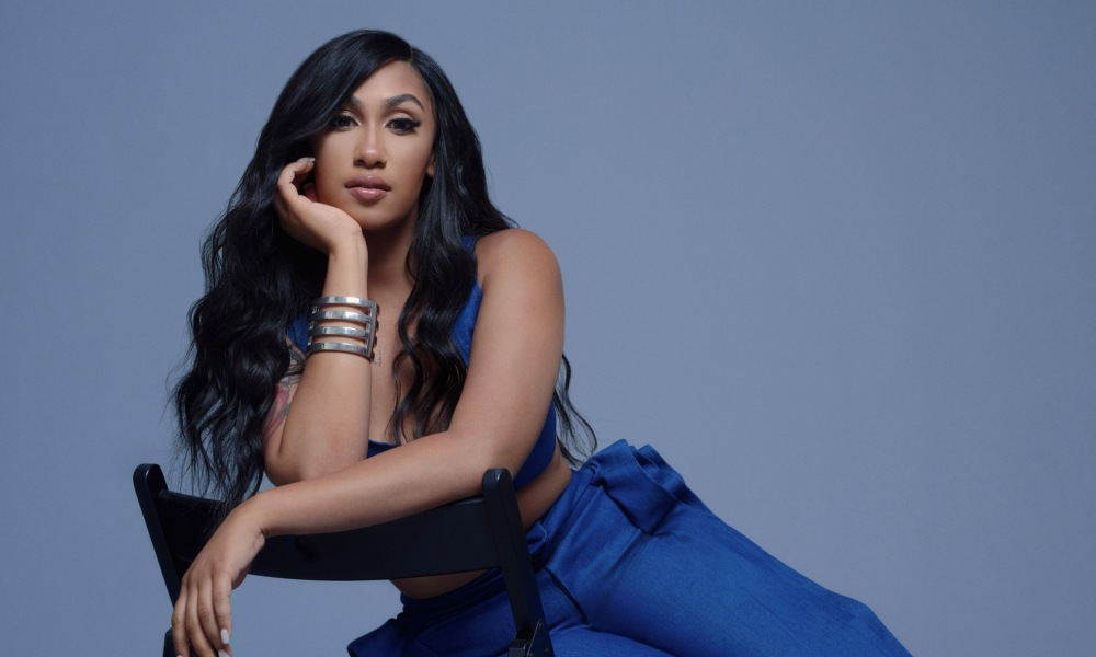 Queen Naija Highlights a Hot-And-Cold Relationship in 'Good Morning Text' Video